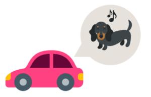 楽しそうに車に乗る犬